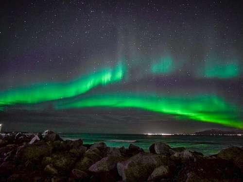 criss cross Northern Lights Iceland