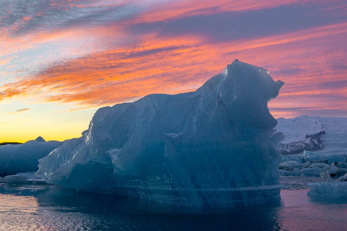 Iceberg under the winter sunset