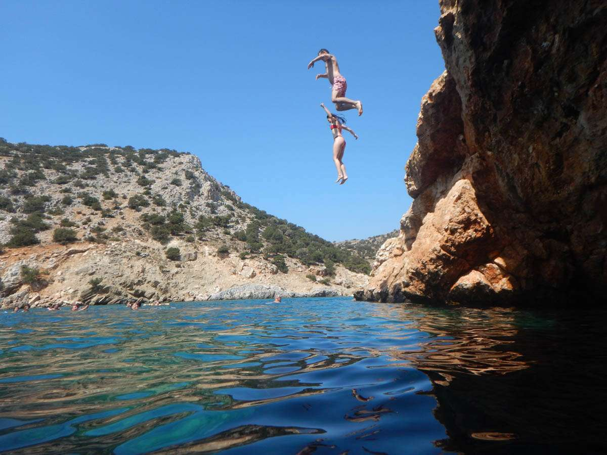 Cliff jumping off Naxos Island Greece